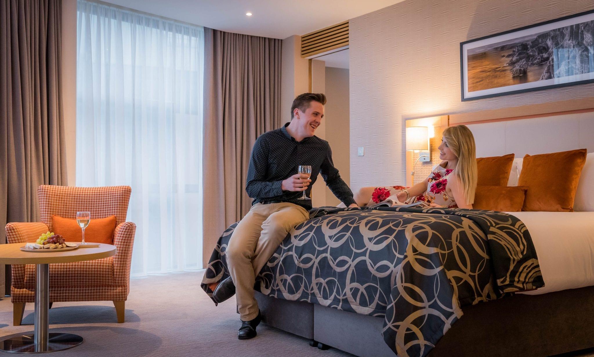 married couple enjoying hotel stay